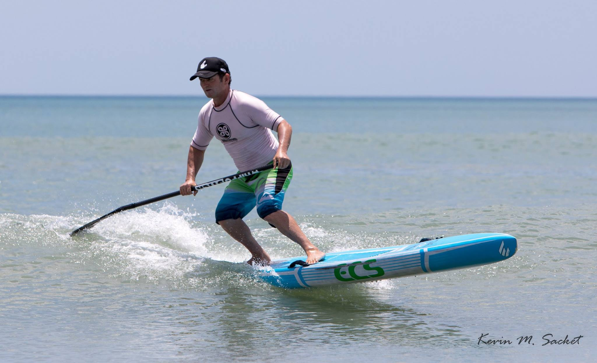Girard Middleton of SoBe Surf & Paddle surfing a ECS Boards Australia Race Board