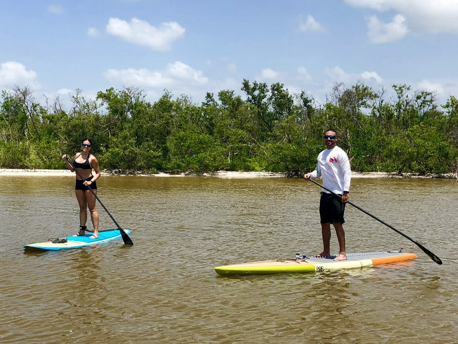 Happy Customers on their new paddle boards from SoBe Surf & Paddle